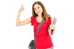 Studentessa felice che dà i pollici su Fotografie Stock