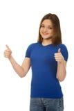 Studentessa felice che mostra i pollici su Fotografia Stock Libera da Diritti