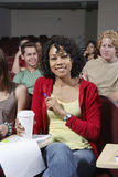 Studentessa felice In Classroom Immagini Stock
