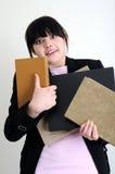 Studentessa preoccupata con i libri Fotografie Stock