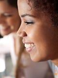 Studentessa Smiling In Classroom Fotografie Stock Libere da Diritti