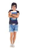 Studentessa sorridente che tiene i suoi libri Fotografia Stock