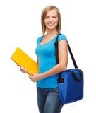 Studentessa sorridente con la borsa e le cartelle Fotografia Stock Libera da Diritti
