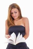 Studentessa triste che tiene un libro aperto Fotografie Stock