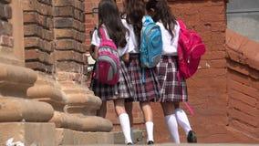 Studentesse con gli zainhi Fotografie Stock