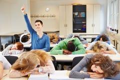 Studenti e diligente addormentati Immagine Stock