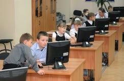 Studenti alla lezione nel laboratorio del computer Fotografie Stock Libere da Diritti