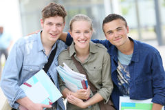 Studenti allegri che tengono i libri Fotografia Stock Libera da Diritti