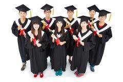 studenti asiatici che celebrano graduazione Fotografia Stock