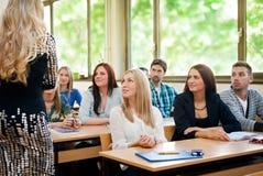 Studenti che ascoltano l'insegnante Fotografia Stock Libera da Diritti