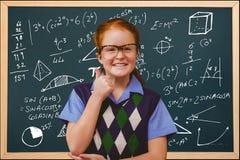 studenti che indossano i vetri contro il fondo di schoolboard Fotografie Stock