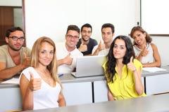Studenti che tengono i pollici su Fotografia Stock Libera da Diritti