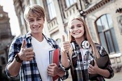 Studenti contentissimi felici che vi esaminano Immagine Stock Libera da Diritti