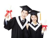 Studenti di istruzione dell'uomo e della donna di graduazione Immagine Stock Libera da Diritti