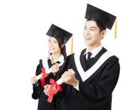 Studenti di istruzione dell'uomo e della donna di graduazione Immagine Stock