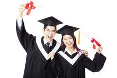 Studenti di istruzione dell'uomo e della donna di graduazione Fotografia Stock