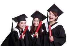Studenti di laureati felici Immagini Stock Libere da Diritti
