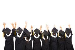Studenti di retrovisione che celebrano graduazione Fotografia Stock