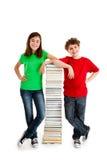 Studenti e mucchio dei libri Fotografia Stock Libera da Diritti