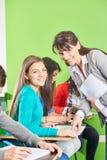 Studenti ed insegnante in un esame Fotografia Stock Libera da Diritti