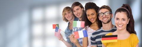 Studenti internazionali davanti a fondo vago Immagini Stock