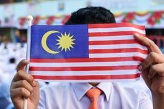 Studenti primari malesi con la bandiera malese durante il celebr Fotografie Stock Libere da Diritti