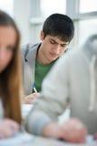 Studenti seri che prendono esame Immagini Stock Libere da Diritti