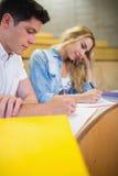 Studenti seri che scrivono durante la classe Fotografia Stock Libera da Diritti