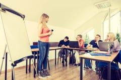 Studenti stanchi ed insegnante in aula Fotografia Stock Libera da Diritti