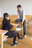 Studenti universitari asiatici Immagini Stock