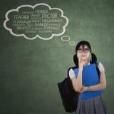 Studentin, die ihre Ideale denkt Lizenzfreie Stockbilder