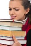 Studentin, die schwere Bücher trägt Stockbild