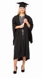 StudentIn Graduation Gown hållande diplom Arkivbild