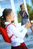 Students. Two young preteens eating apples at school Stock Photos