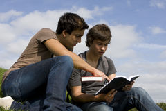 Students. Two college or university students studying on the park Royalty Free Stock Image