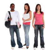 Students. Three attractive students standing next to each other in front of a plain white background Royalty Free Stock Photo