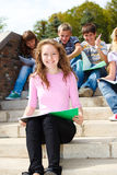 Students. Lovely Teenage students sitting on stairway Royalty Free Stock Photo