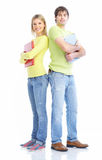 Students. Young smiling  students. Isolated over white background Royalty Free Stock Photo