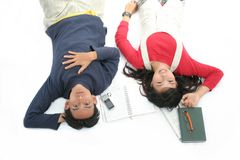 Students. Lie down on the floor next by books Stock Images