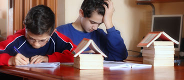 Students. Two students on the desk with books, build your future Royalty Free Stock Images