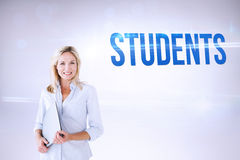 Students against grey background Royalty Free Stock Photos
