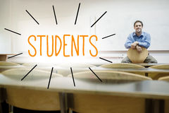 Students against lecturer sitting in lecture hall Stock Photo