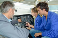 Students in aircraft cockpit stock images