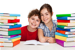 Free Students And Pile Of Books Stock Image - 15962631