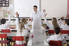 Students answering chemistry teacher?s questions in classroom Royalty Free Stock Photography