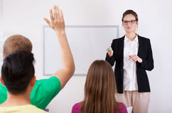 Students answering teacher question Royalty Free Stock Images