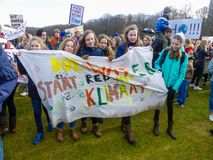 Students at anti climate change protest in The Hague with banners walking through the city