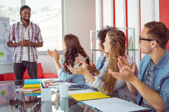 Students applaud a colleague Royalty Free Stock Photos