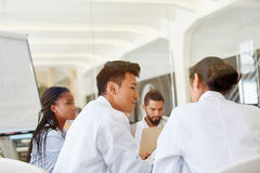 Students in apprenticeship workshop. Discuss medical diagnose royalty free stock photography