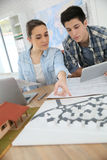 Students in architecture working on project using tablet Royalty Free Stock Photos